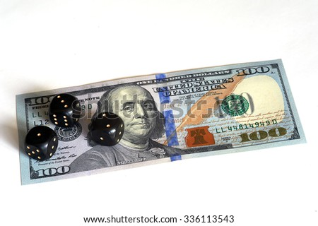 Three dice and banknote of hundred dollars