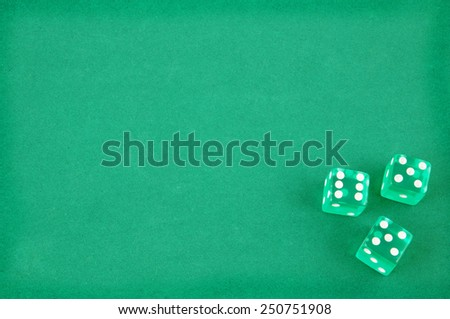 Three dices on green gaming table - stock photo
