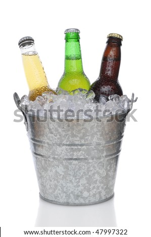 Three Different Beer Bottles in bucket of ice with condensation vertical composition over white background
