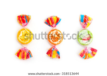 three different candies on white - stock photo