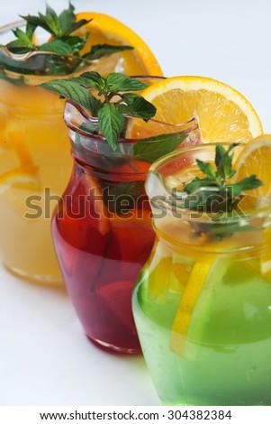 Three different cold drinks Fresh juice mix Three of fruit cocktails. Fruit cold tea cocktails. - stock photo