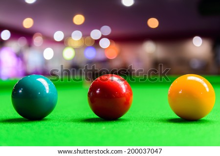 Three different colour snooker balls on the table