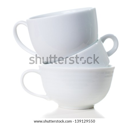 Three different empty white coffee cups are stacked, isolated - stock photo