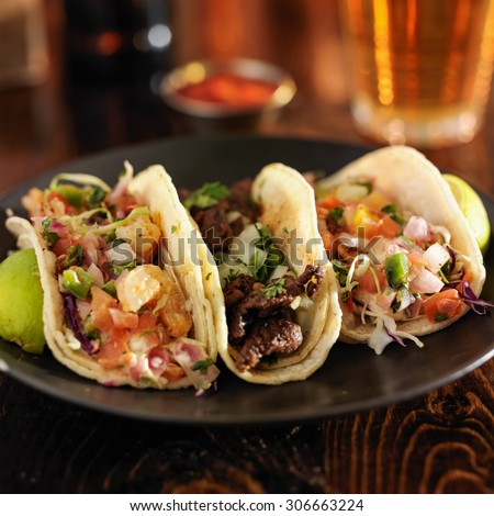 three different mexican street tacos with shrimp, steak, and fish - stock photo