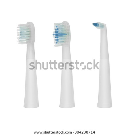 Three different replacement brush heads for electric toothbrush isolated on a white background - stock photo