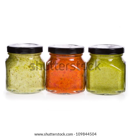 Three different sauces in glass jars  isolated on white background - stock photo