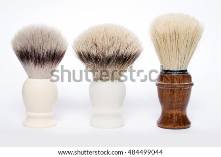 three different shaving brushes: synthetic, silvertip badger and a boar brush (from left to right)