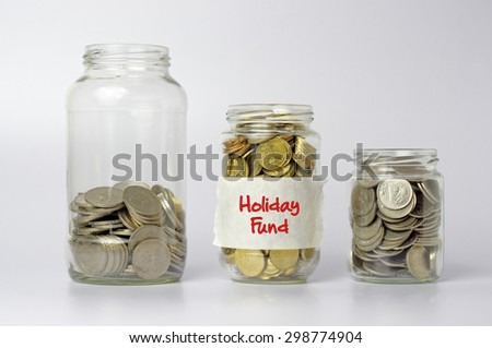 Three different size of jars with Holiday fund text - Financial Concept