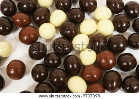 Three different types of chocolate candies. Abstract background