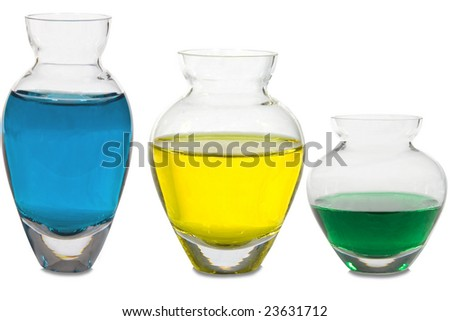 Three different vases with colored water in them