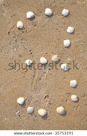 three digit symbol from shells in a sand