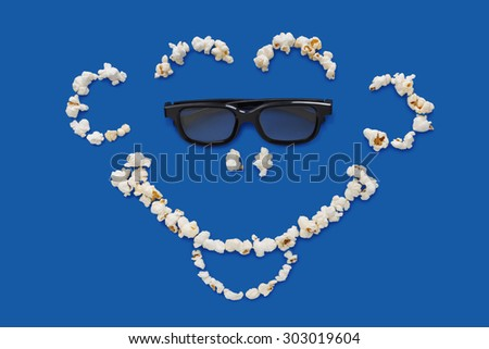 three-dimensional 3d technology conceptual photo of smiling face on a blue background - stock photo
