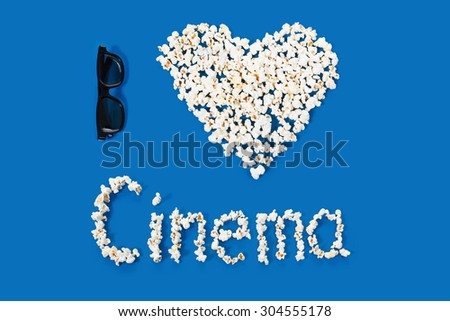 three-dimensional 3d technology conceptual photo of symbol, heart shape. with the inscription letters cinema on a blue background - stock photo