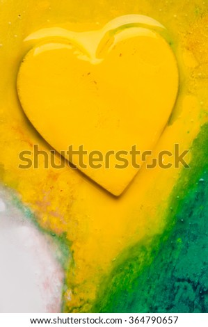 Three-dimensional hand-painted yellow on colorful background. Gift for Valentine's Day.