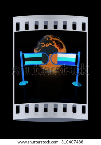 Three-dimensional image of the turnstile and flags of Germany and Austria on a black background. The film strip - stock photo