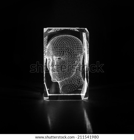 Three-dimensional projection of a human head. Laser engraving inside the glass.