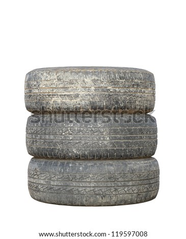 three dirty used tires isolated over white background - stock photo