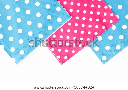 Three dotted napkins isolated on a white background - stock photo