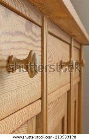 Three drawers of a wooden cabinet or a chest with knobs, pigeon-hole thinking  - stock photo