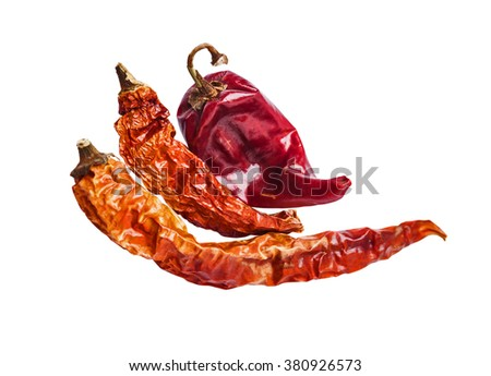 Three dried chili peppers on a white background