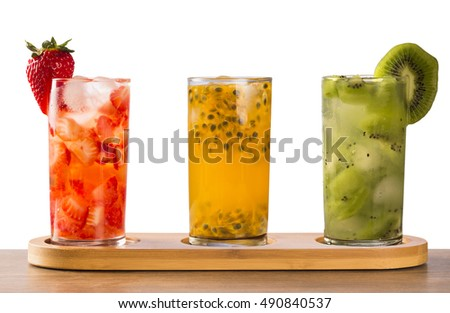Three drinks made with passion fruit, strawberry and kiwi Caipirinha on white background