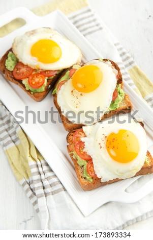 Three Egg, Bacon, Tomatoes Sandwiches on White - stock photo