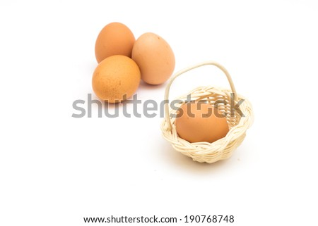 three eggs in basket  isolated on white background - stock photo