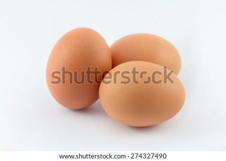 Three eggs isolated on white background - stock photo