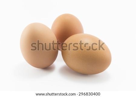 Three eggs isolated on white background. - stock photo