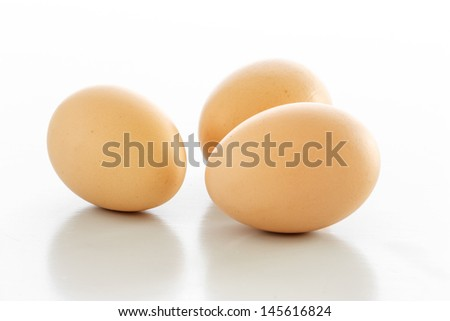 Three eggs isolated over a white background.  - stock photo