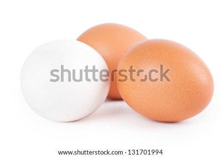 Three eggs on white background, closeup