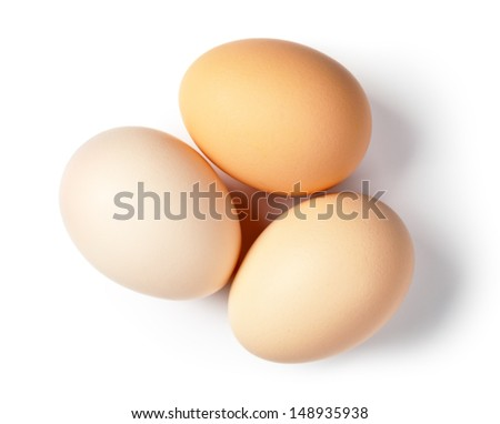 Three eggs on white background. Top view - stock photo