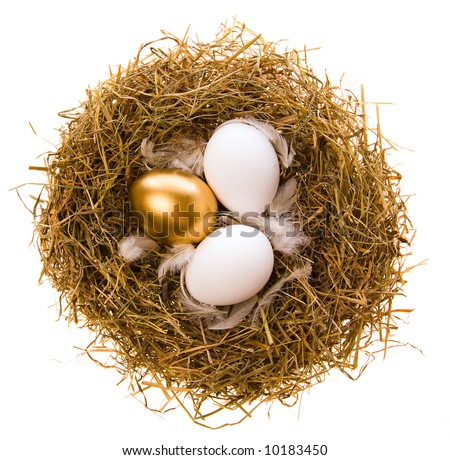 Three eggs, two white and one gold in a nest from the dried up grass on a white background