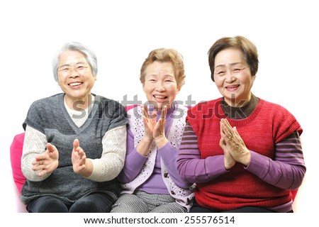 Three elderly women of good relationship with a smile
