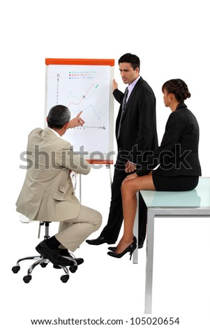 Three employees in business meeting - stock photo