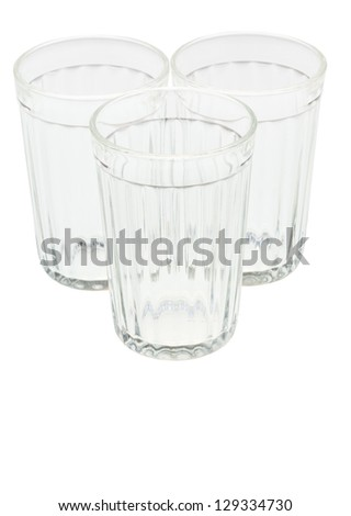 three empty faceted tumblers isolated on white background - stock photo