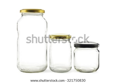 Three empty glass jars on white - stock photo