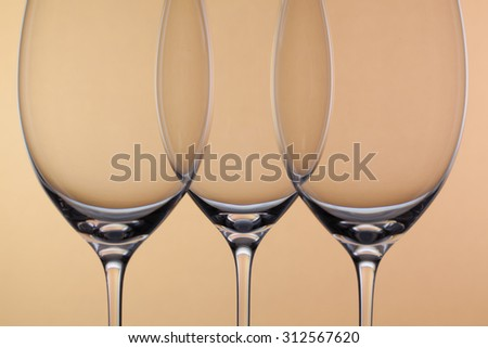 Three empty glasses of wine on a background