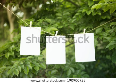 three empty photo holding on rope