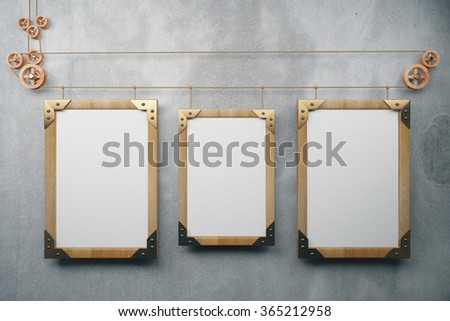 Three empty picture frame in the style of steampunk hanging on a concrete wall, mock up 3D Render - stock photo