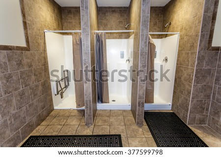 Three Empty Showers in Gym Locker Room