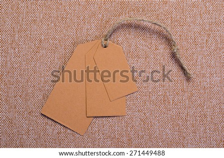 three empty tags on a textile background - stock photo