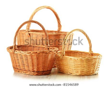Three empty wicker baskets isolated on white - large, medium and small - stock photo