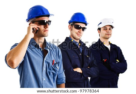 Three engineers at work - stock photo