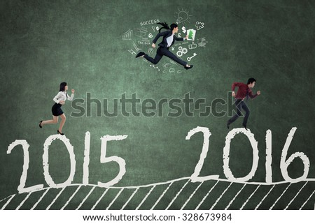 Three entrepreneurs running and compete to each other for achieving at the numbers 2016 - stock photo