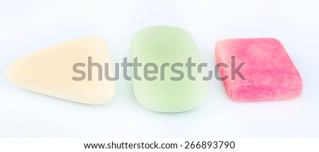 Three erasers isolated on white - stock photo
