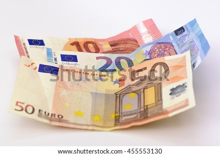 three Euro banknotes as group laying on table