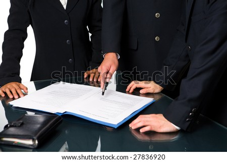 Three executives in meeting room discussing about the agreement.