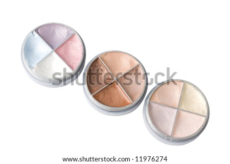 Three eye shadows isolated on white