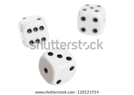 Three falling dice on white background.